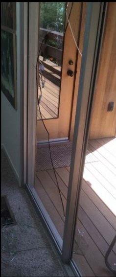 Investigators say the intruders in Friday's burglary used a rock to smash a rear sliding door. PHOTO: Lafayette PD